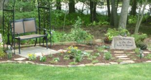 Our memorial garden for our son, featuring a custom made stone.